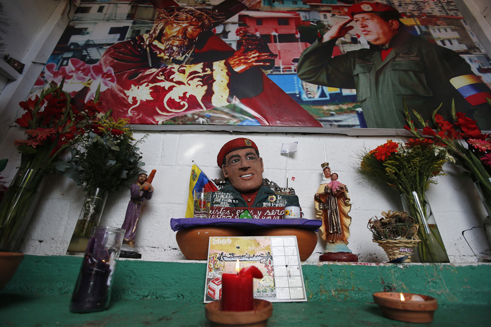 Candles and flowers are displayed inside a chapel dedicated to the late Venezuelan President Hugo Chavez, outside his mausoleum in Caracas
