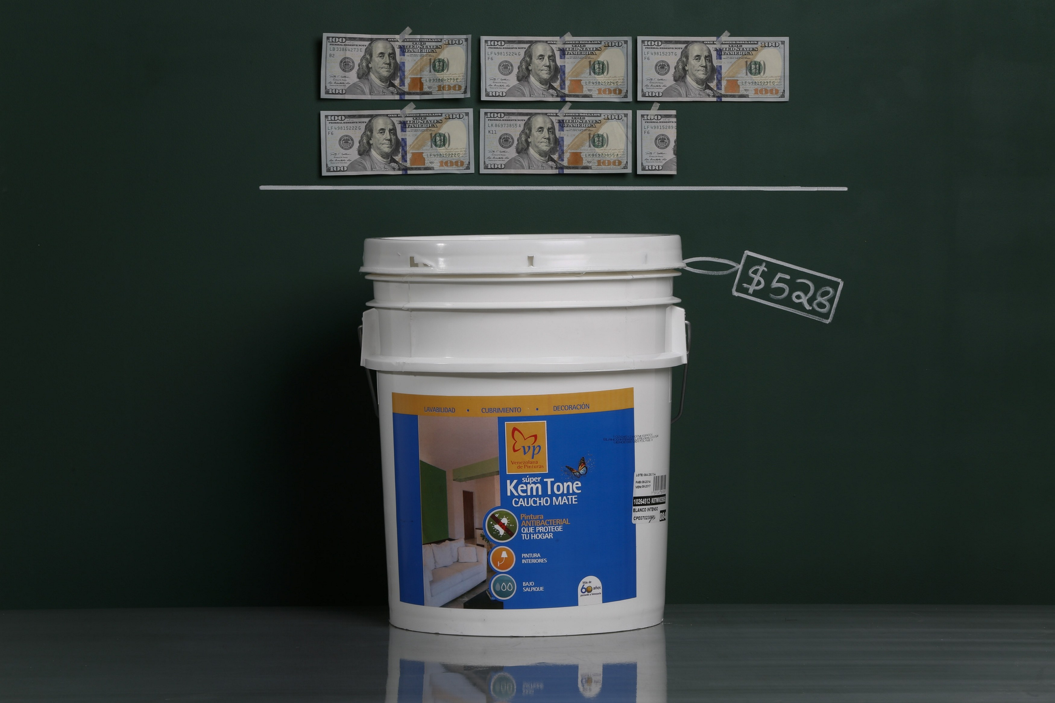 A five-gallon bucket of house paint as photographed with an illustrative price tag of $528 in Caracas