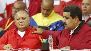 Venezuela's President Nicolas Maduro talks next to National Assembly President Diosdado Cabello at a meeting of the United Socialist Party in Caracas