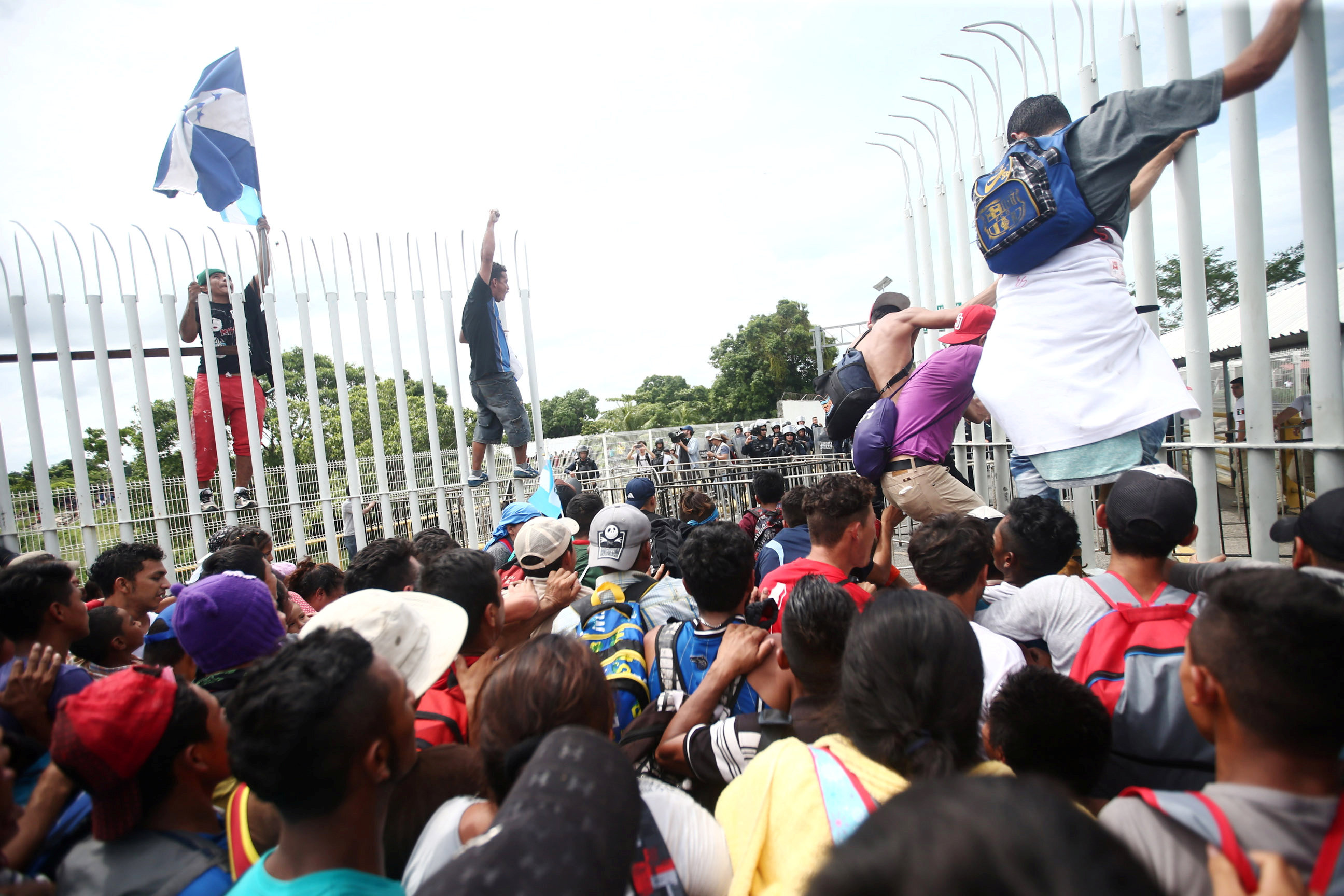 Honduran migrants, part of a caravan trying to reach the U.S., storm a border checkpoint, in Ciudad Hidalgo