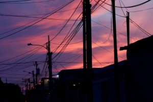 Electrical posts and power lines are seen at sunset during a blackout in Maracaibo