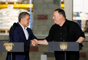 U.S. Secretary of State Mike Pompeo and Colombia's President Ivan Duque shake hands during a news conference at a warehouse where international humanitarian aid for Venezuela is being stored, in Cucuta
