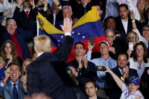 U.S. President Donald Trump waves after speaking about the crisis in Venezuela during a visit to Florida International University in Miami