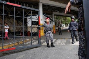 Police officers stand guard at the entrance of a detention centre of the Bolivarian National Intelligence Service (SEBIN) in Caracas
