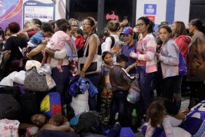 Venezuelan migrants wait at the Binational Border Service Center of Peru in Tumbes