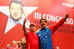 FILE PHOTO: Venezuela's President Nicolas Maduro (R) embraces retired General Hugo Carvajal as they attend the Socialist party congress in Caracas